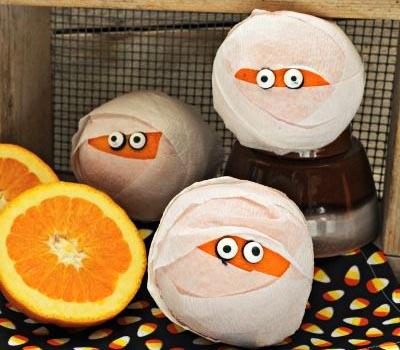 фото цитрусовых мумий: сладкое оформление хэллоуина